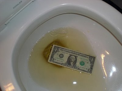 Casey Serin pissed on a dollar bill, just to show how grateful he is about the USA accepting his family as immigrants. No, we do not forget.